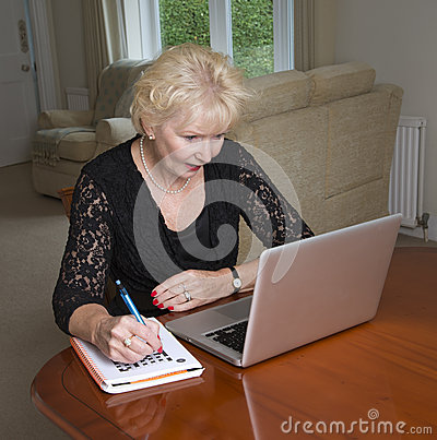 Free Woman In Her Sixties Completing A Crossword Royalty Free Stock Photography - 56818177