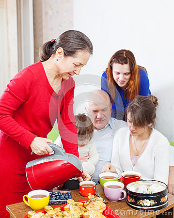 Free Woman In Red Pours Tea For Family Stock Image - 29736151