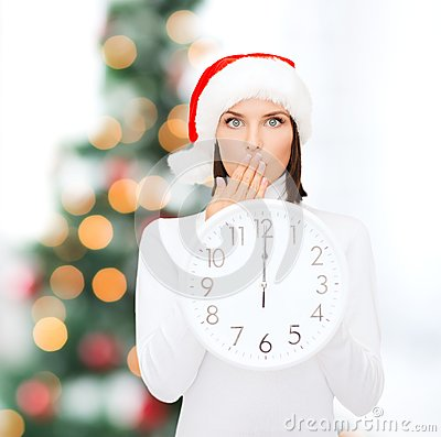Free Woman In Santa Helper Hat With Clock Showing 12 Stock Photography - 37623692