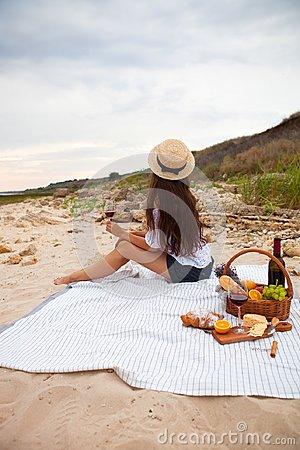 Free Woman In Summer Picnic On The Beach At Sunset In The White Plaid Royalty Free Stock Images - 108897329