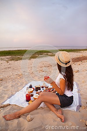 Free Woman In Summer Picnic On The Beach At Sunset In The White Plaid Stock Photo - 109125870