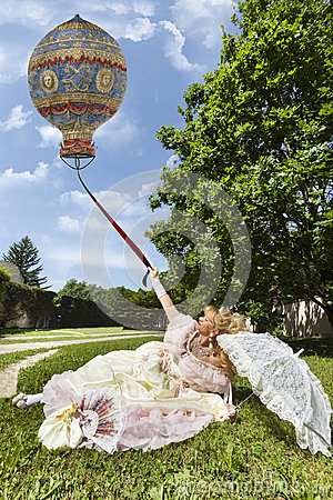 Free Woman In Venetian Costume Lying On The Green Park Holding An Old Balloon Royalty Free Stock Photography - 80809787