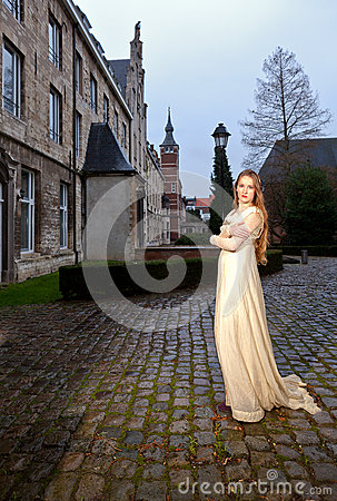 Free Woman In Victorian Dress In A Old City Square In The Evening In Profile Stock Images - 37447554