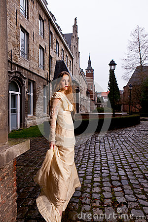 Free Woman In Victorian Dress In A Old City Square In The Evening In Profile Stock Photo - 37447670