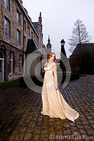 Free Woman In Victorian Dress In A Old City Square In The Evening Walking Stock Photos - 37447353