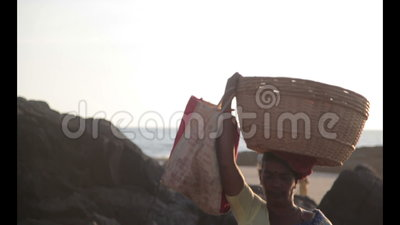 Woman india. Woman carrying basket full of fruits on the top of his head. Goa-India stock video footage
