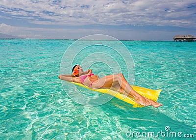 woman inflatable raft tropical resort