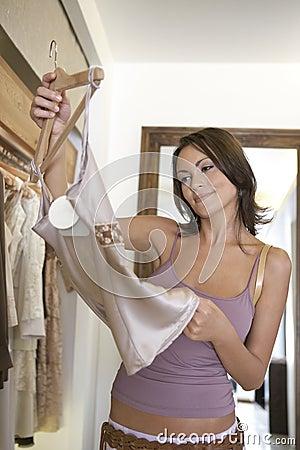 Woman Inspecting Dress