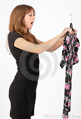 Woman inspecting wardrobe