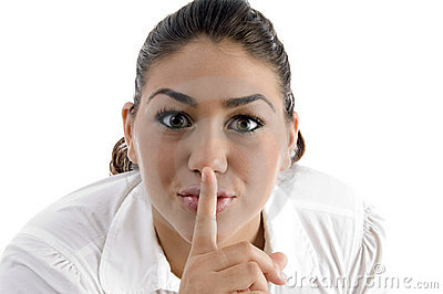 Woman instructing to be silent