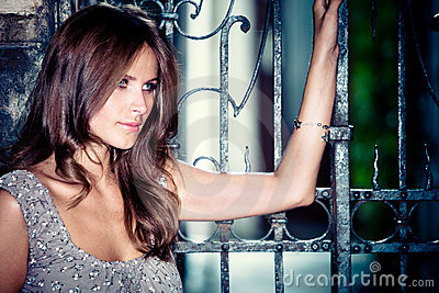 woman by the iron gate portrait