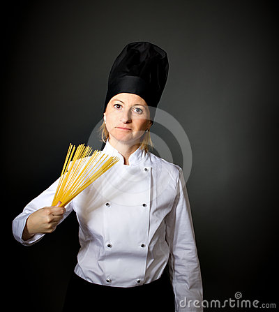 Woman italian cook chef wiht spaghetti
