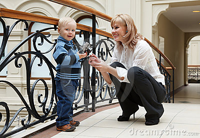 Woman and its small son use digital camera