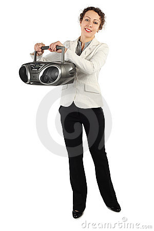 Woman in jacket holding tape recorder and smiling