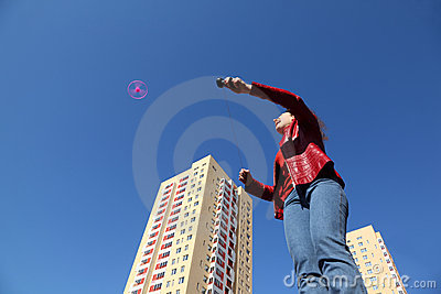 Woman in jacket and jeans playing with propeller