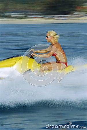 A woman on a jet ski