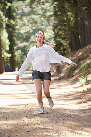 Woman Jogging Happily Along A Country Lane Royalty Free ...