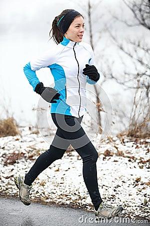 Woman jogging in a snowy landscape