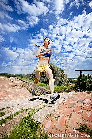 Woman Jogging Up Steps
