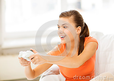 Woman with joystick playing video games Stock Photo
