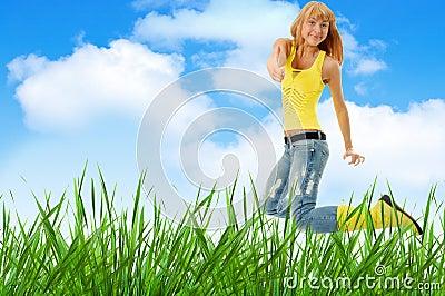 Woman jump over grass