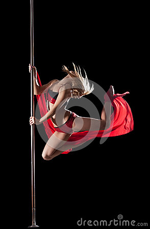 Woman jump during pole dance with fabric