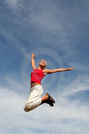 Free Woman Jumping Against Blue Sky Stock Image - 1026561