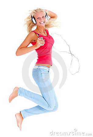 Woman jumping in the air while listening to music