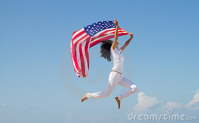 Woman jumping with american flag