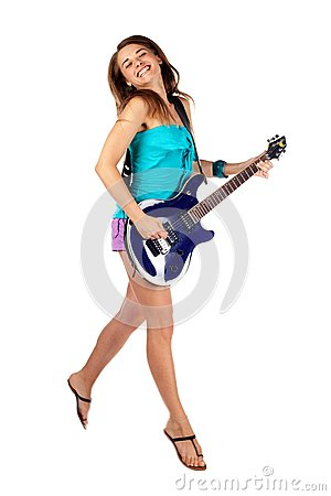 Woman jumping with an electric guitar. Isolated