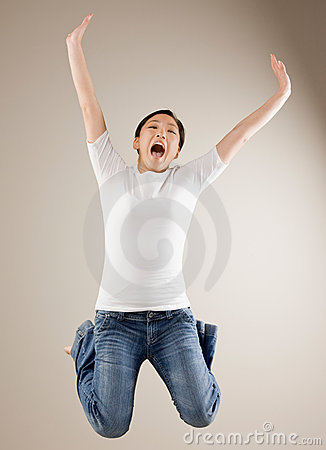 Woman jumping in mid-air cheering