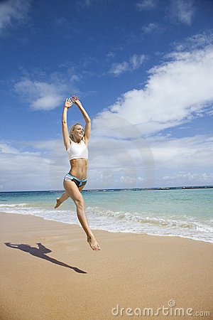 Free Woman Jumping On Beach. Stock Image - 2038031