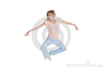 Woman jumping and opening arms