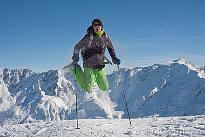 Woman  jumping over the snowy mountains, austria