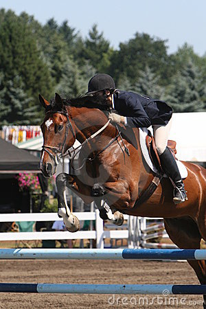 Woman jumping Oxer