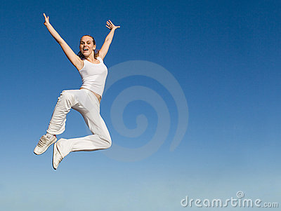 Woman jumping with success