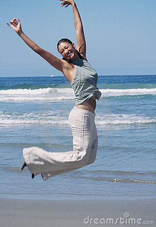 Woman Jumps in Air with Joy