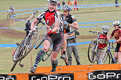 Woman Jumps Barrier at Cycloross Event Editorial Photography