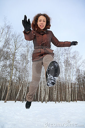 Woman jumps forward, winter day
