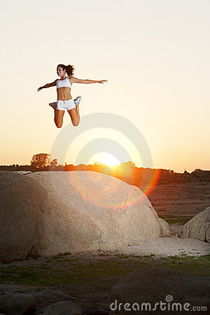 A woman jumps for joy