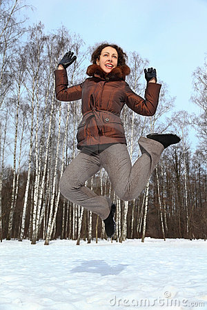 Woman jumps up to sky, winter