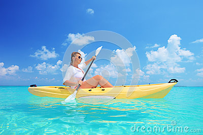 A woman kayaking on a sunny day