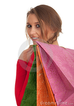 Woman keeping coloured shopping bags
