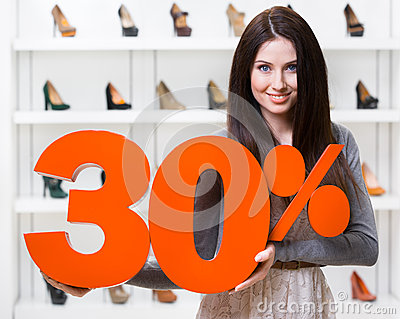 Woman keeps the model of 30  sale on footwear