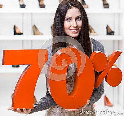 Woman keeps the model of 70  sale on footwear