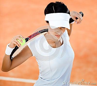 Woman keeps tennis racket