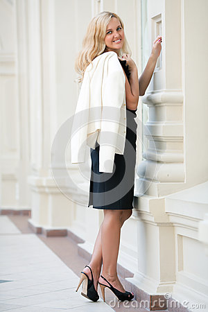 Woman keeps a white jacket