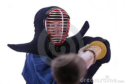 Woman in kendo helmet prepared to fight