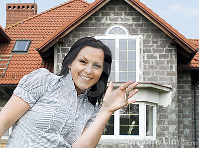 Woman with keys to the new house