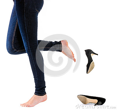 Woman kick off her shoes